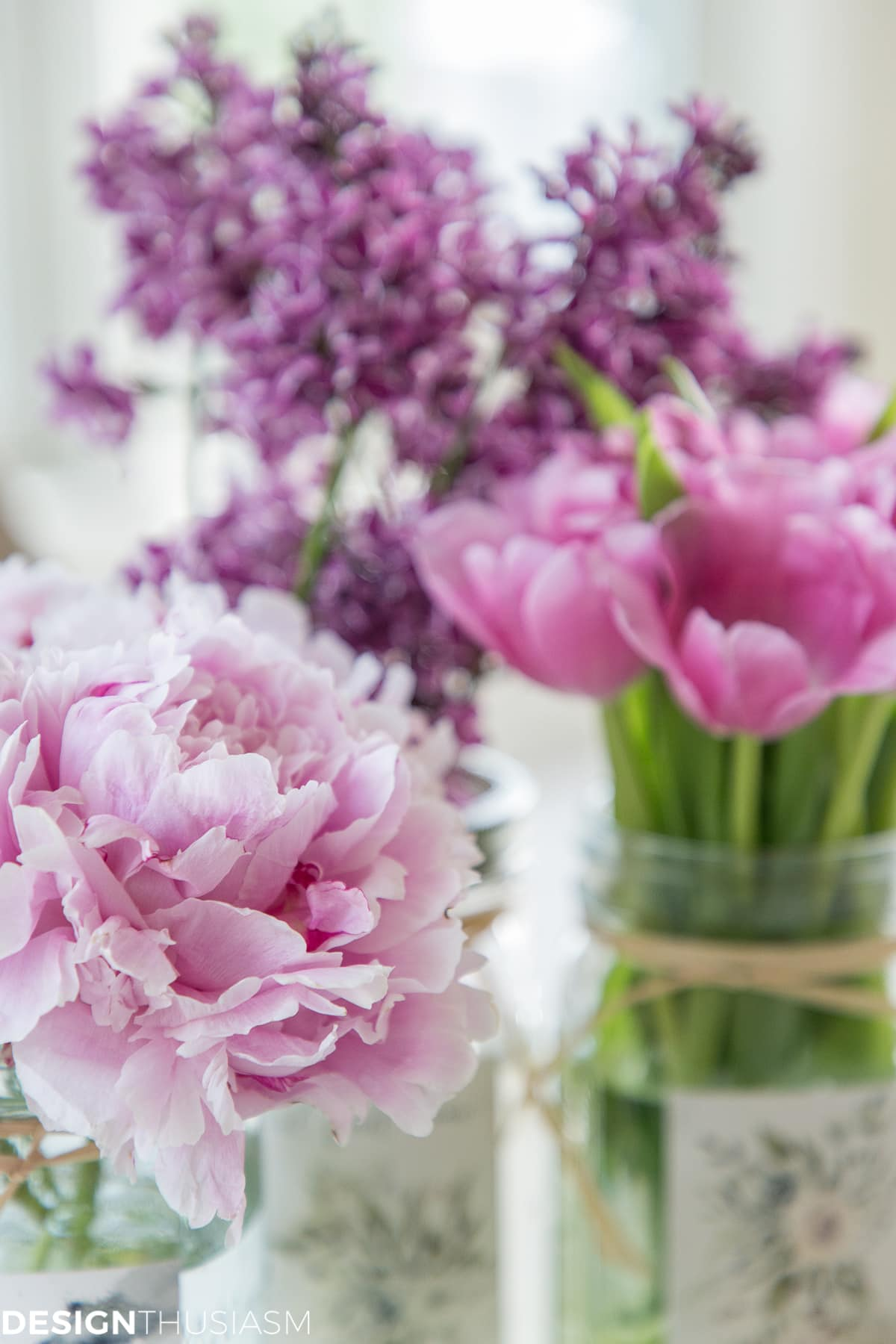 peonies, tulips and lilacs in mason jars