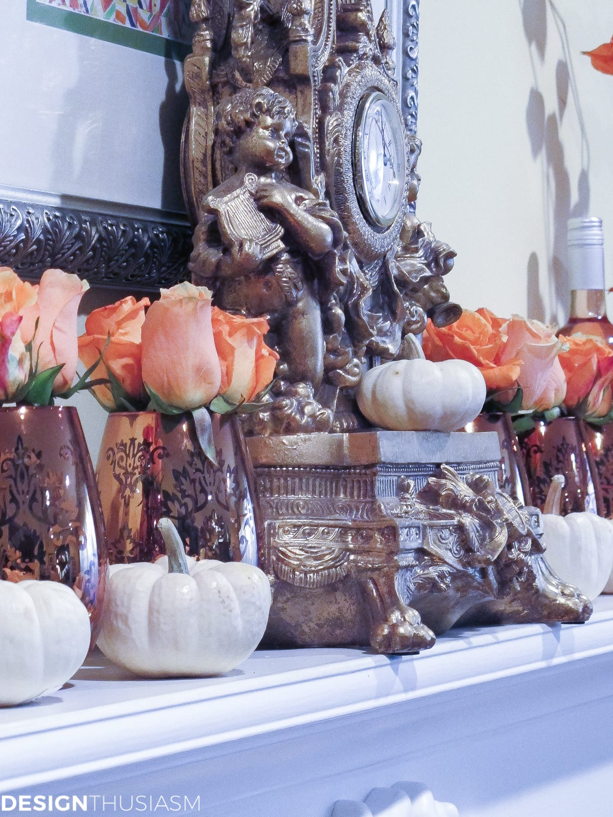 fall mantel with white pumpkins and orange roses