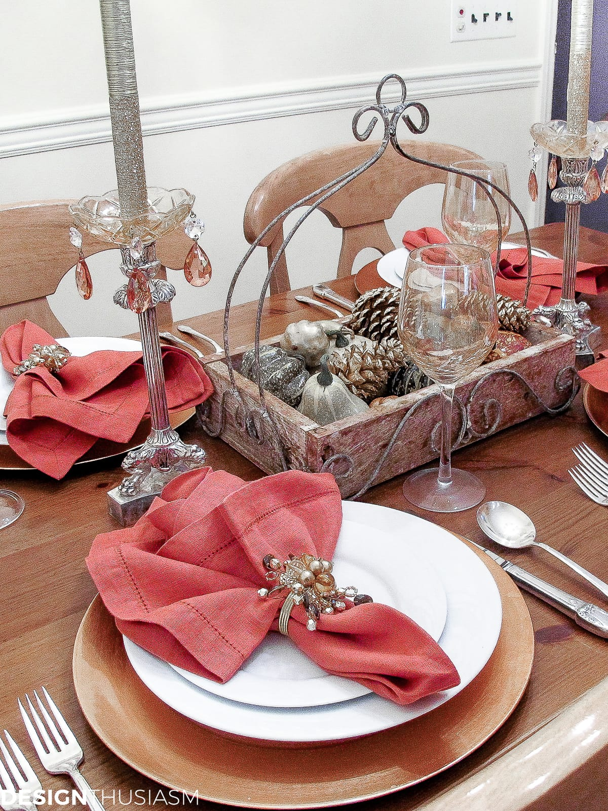 casual fall table setting with rust napkins, pumpkins and gourds
