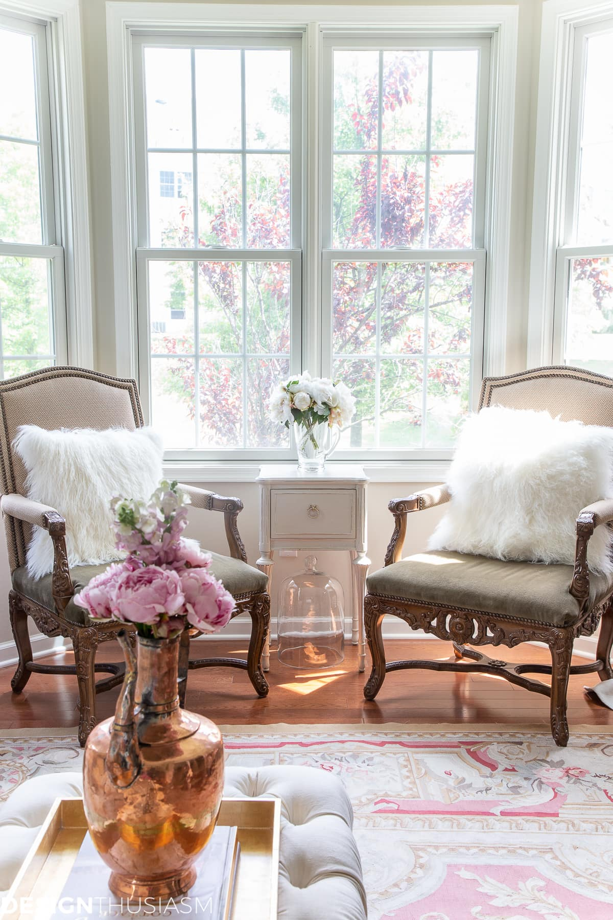 living room decor with a pair of throne chairs