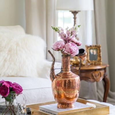 Adding Warmth to Your Living Room Decor with Pink and Copper Accents