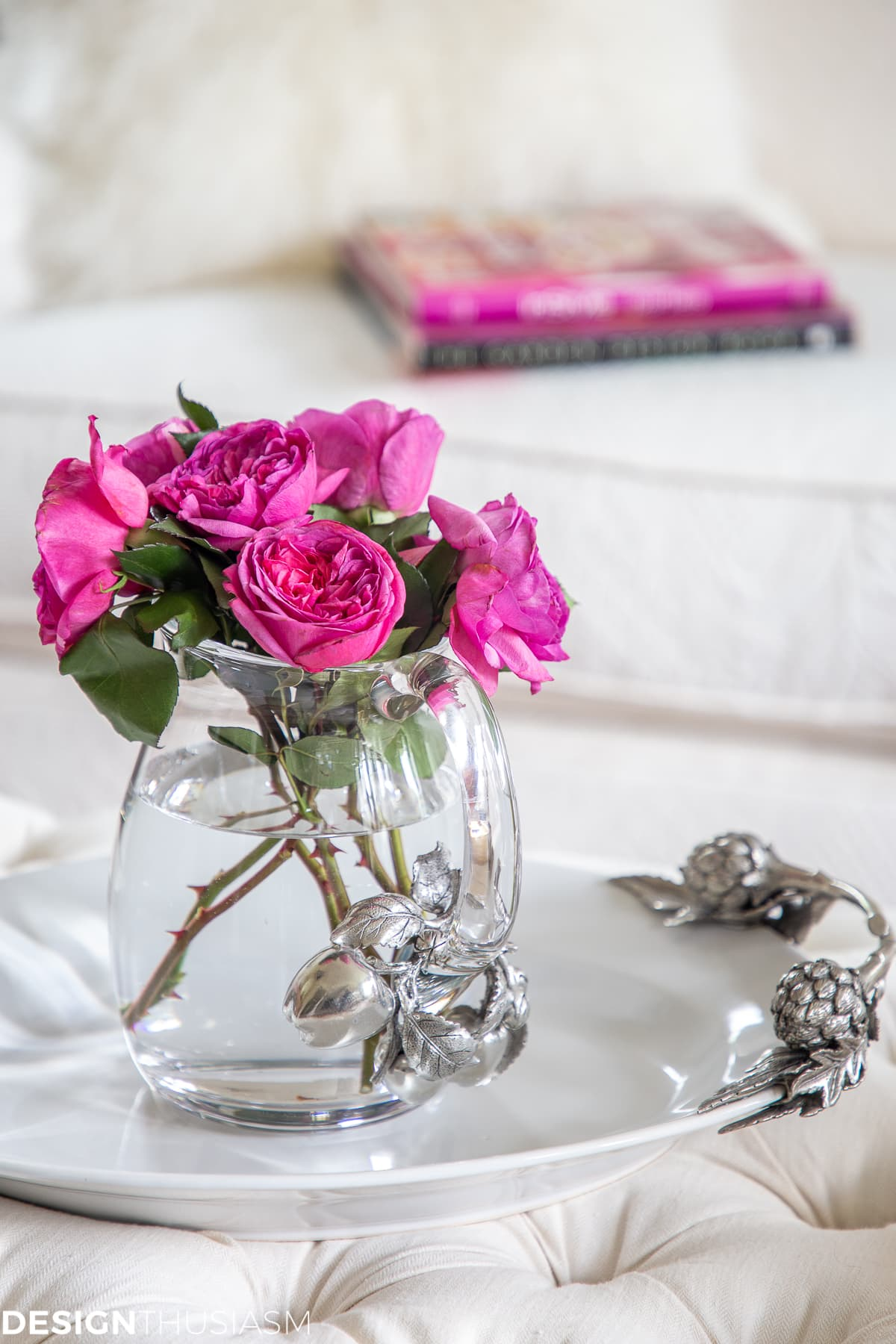 living room decor with pink roses in a pitcher