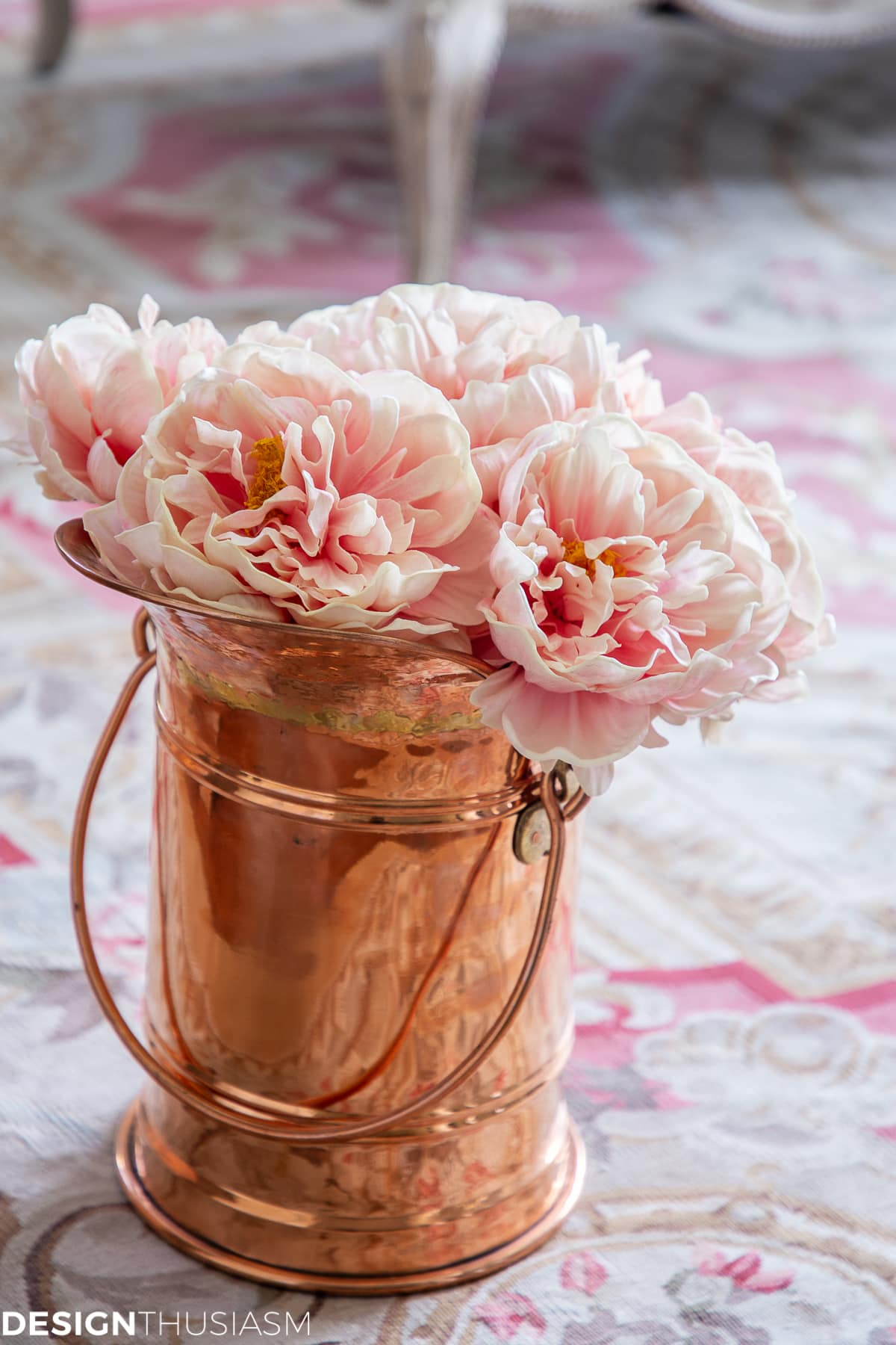 living room decor with faux peonies in a copper vase