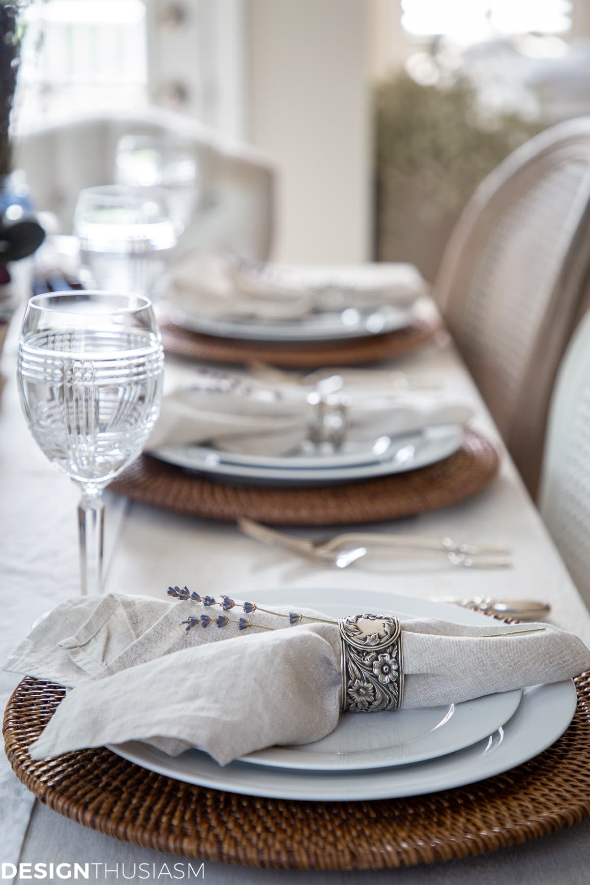 summer tablescape with linen napkins, chair covers and lavender sprigs
