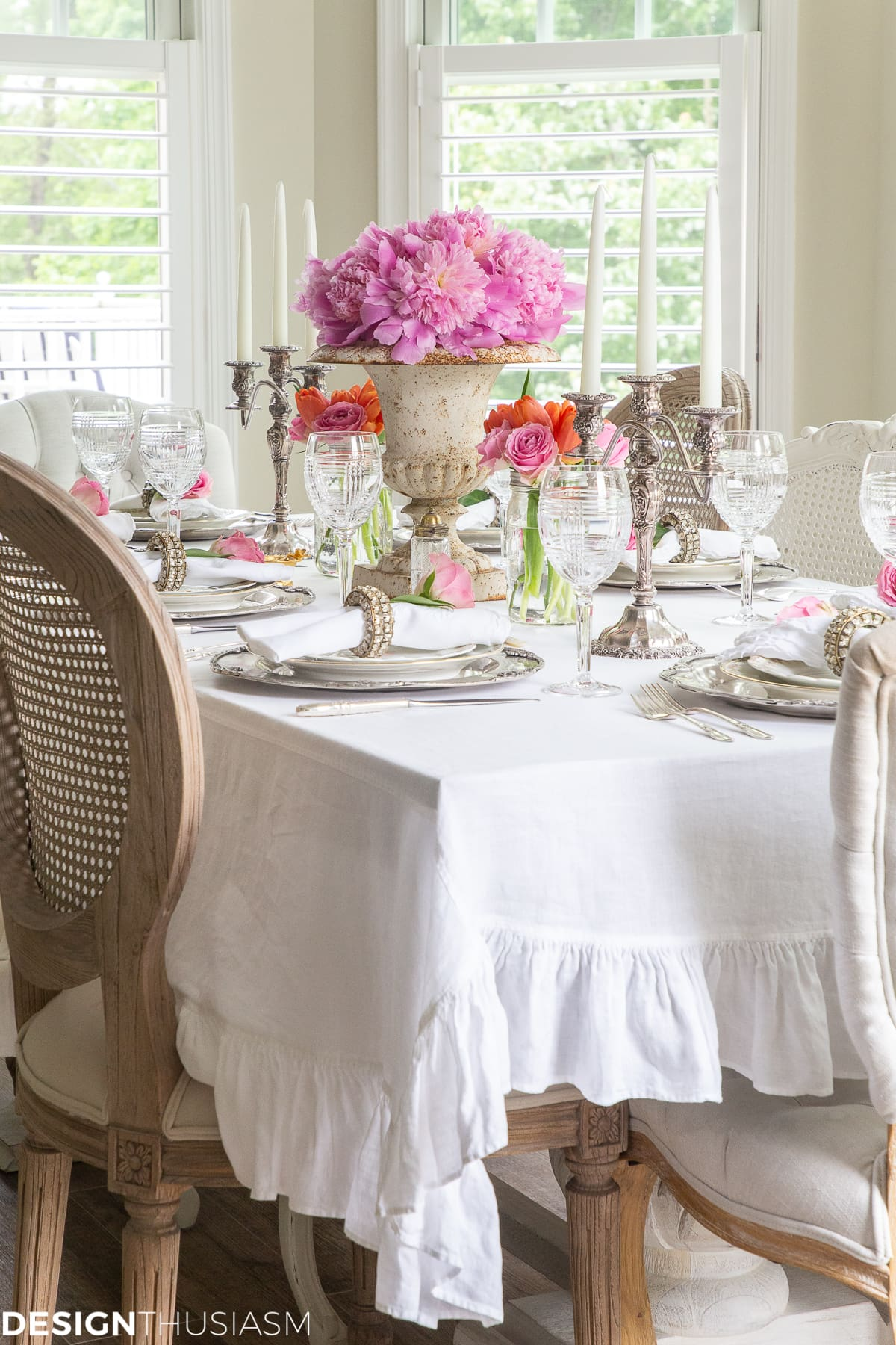 white dining table setting with a ruffle tablecloth
