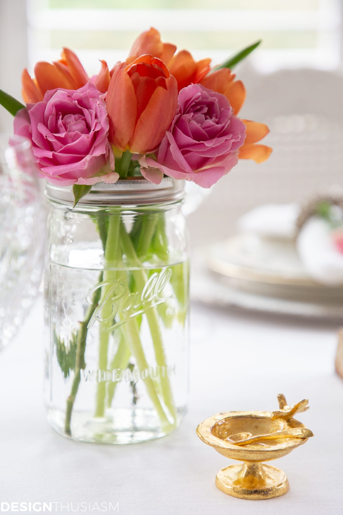 pink and orange flowers in a summer table setting