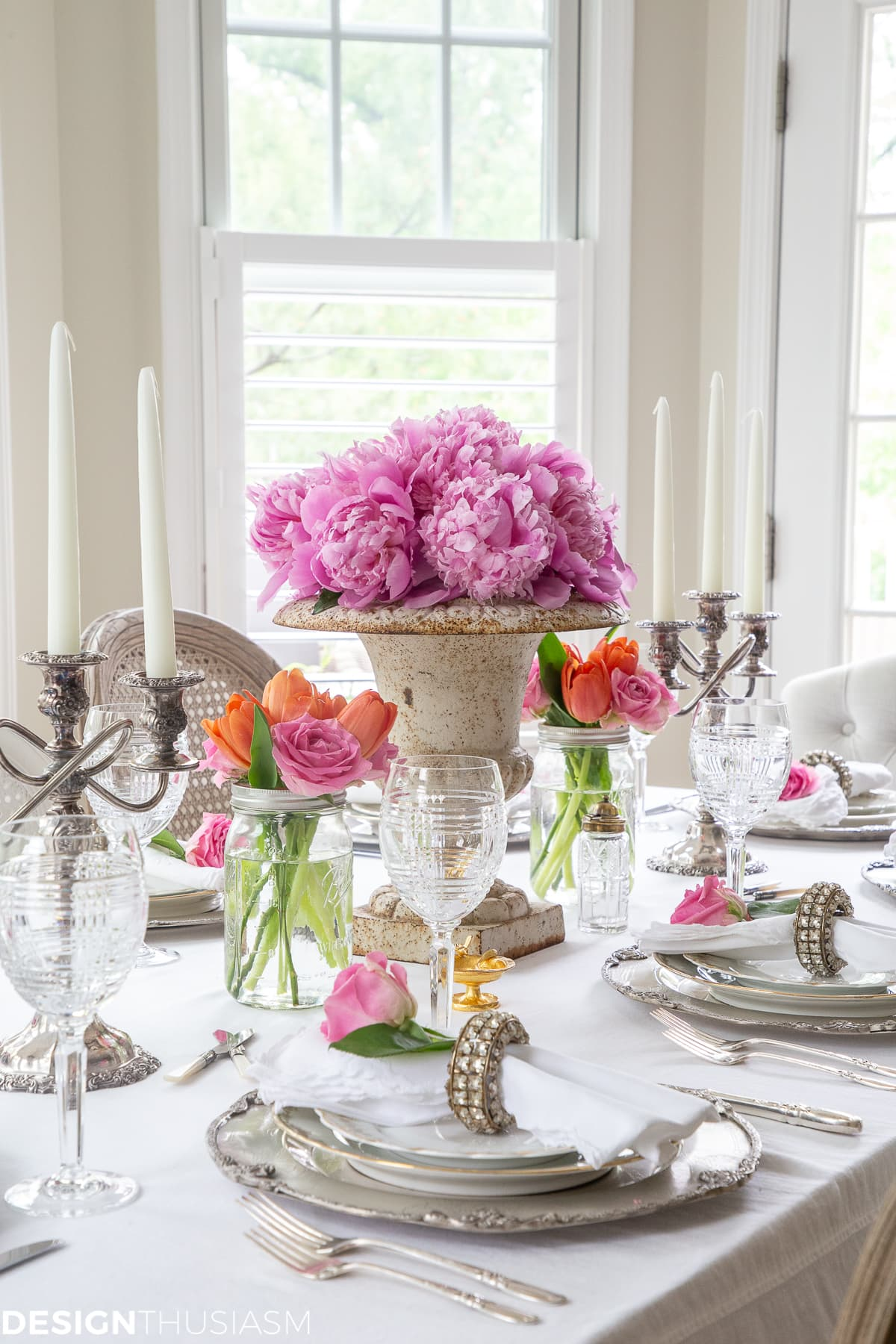 white dining table setting with summer color florals