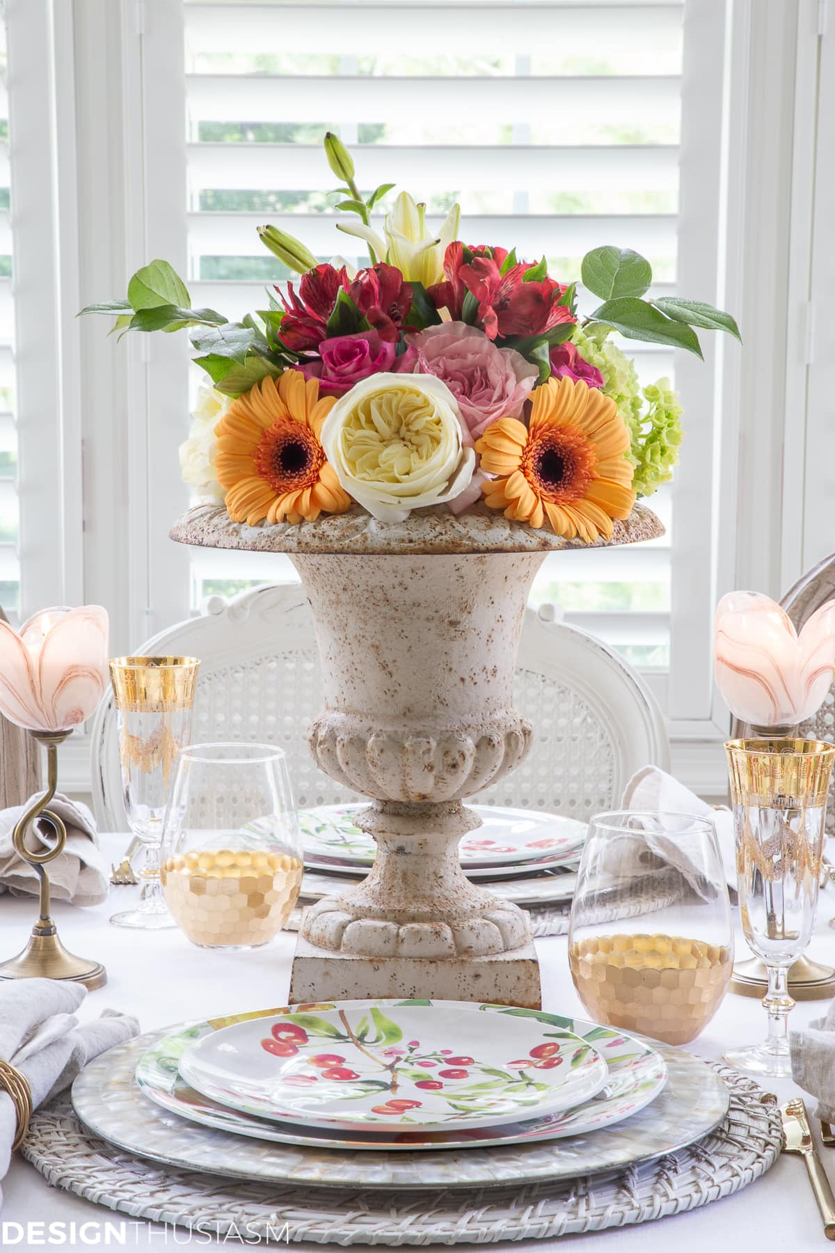 informal table setting with flowers in garden urn