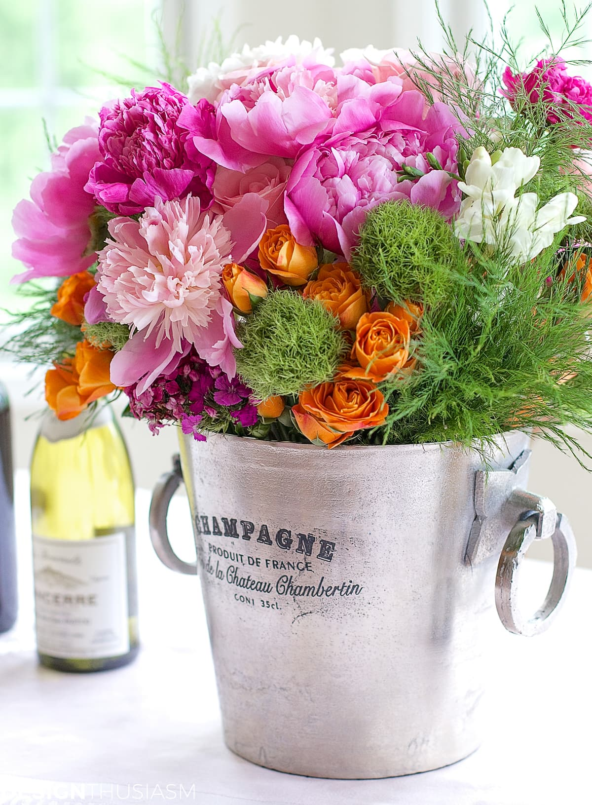 flower arrangement ideas in a champagne bucket with pink flowers