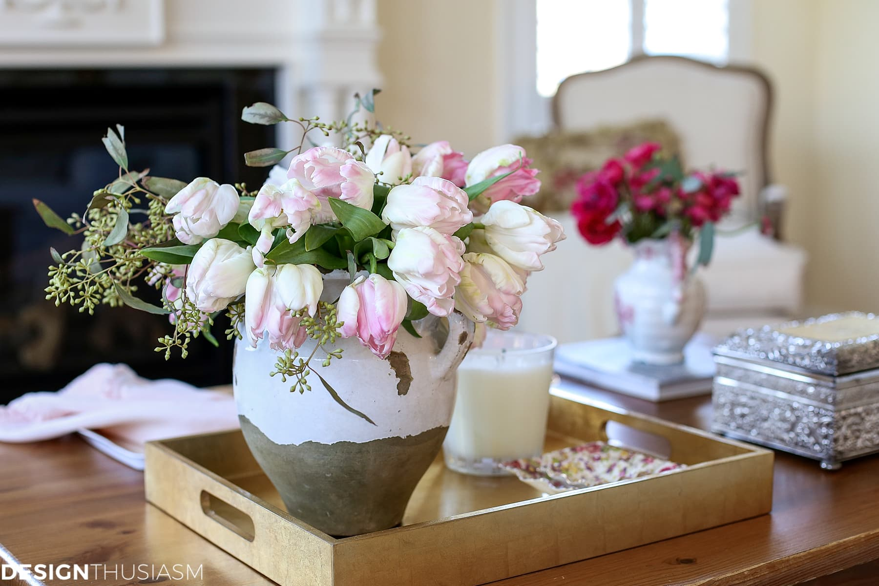two flower arrangements with pink flowers