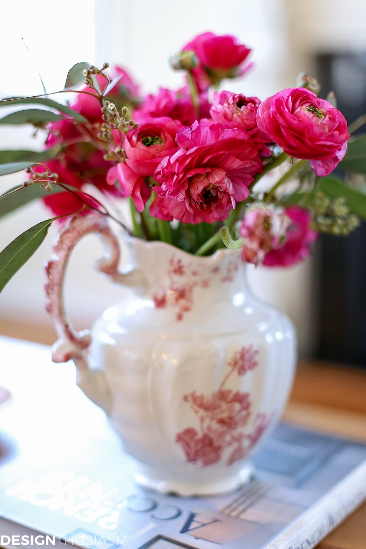 pink flowers in a transferware pitcher