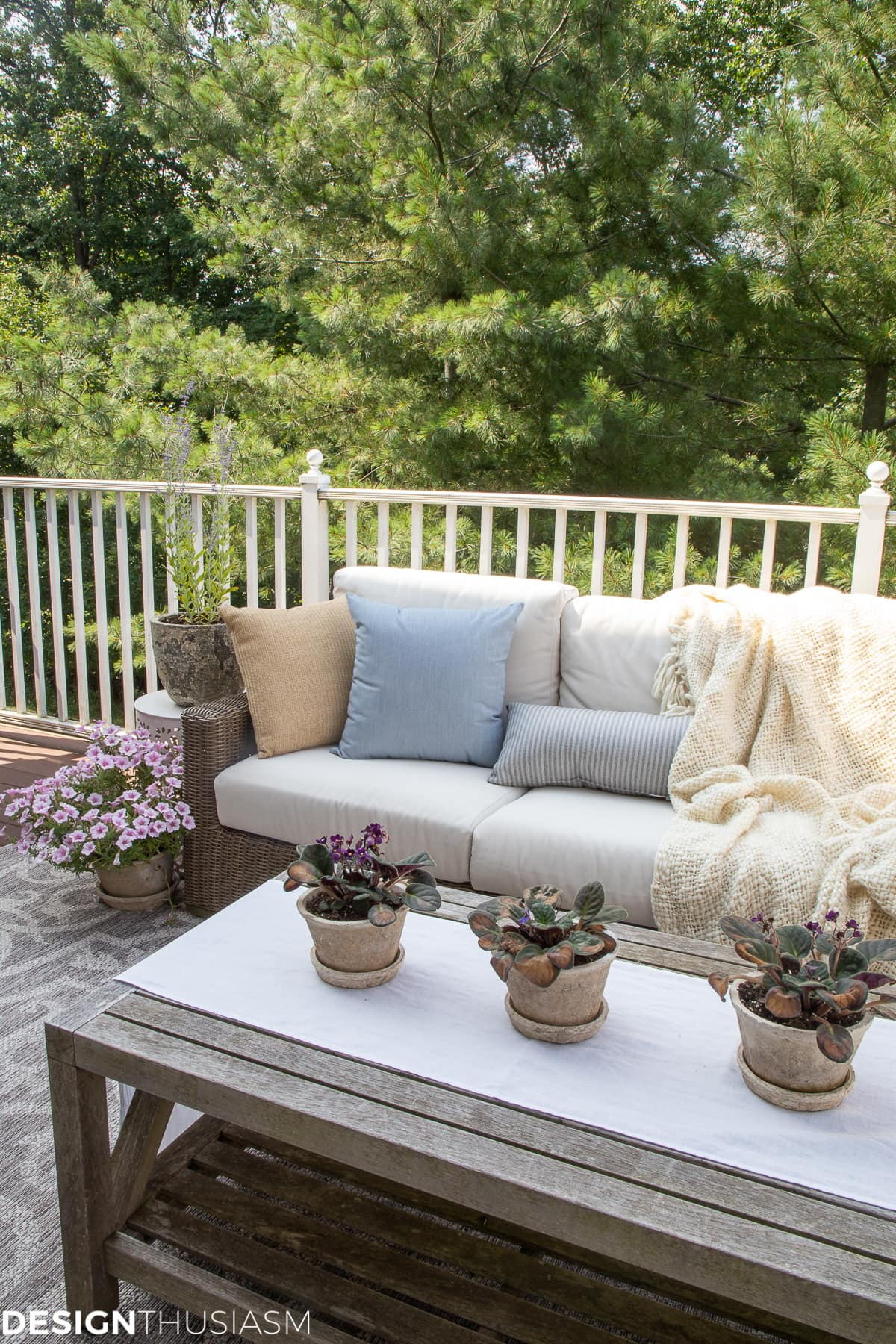 outdoor decor pillows and clay pots