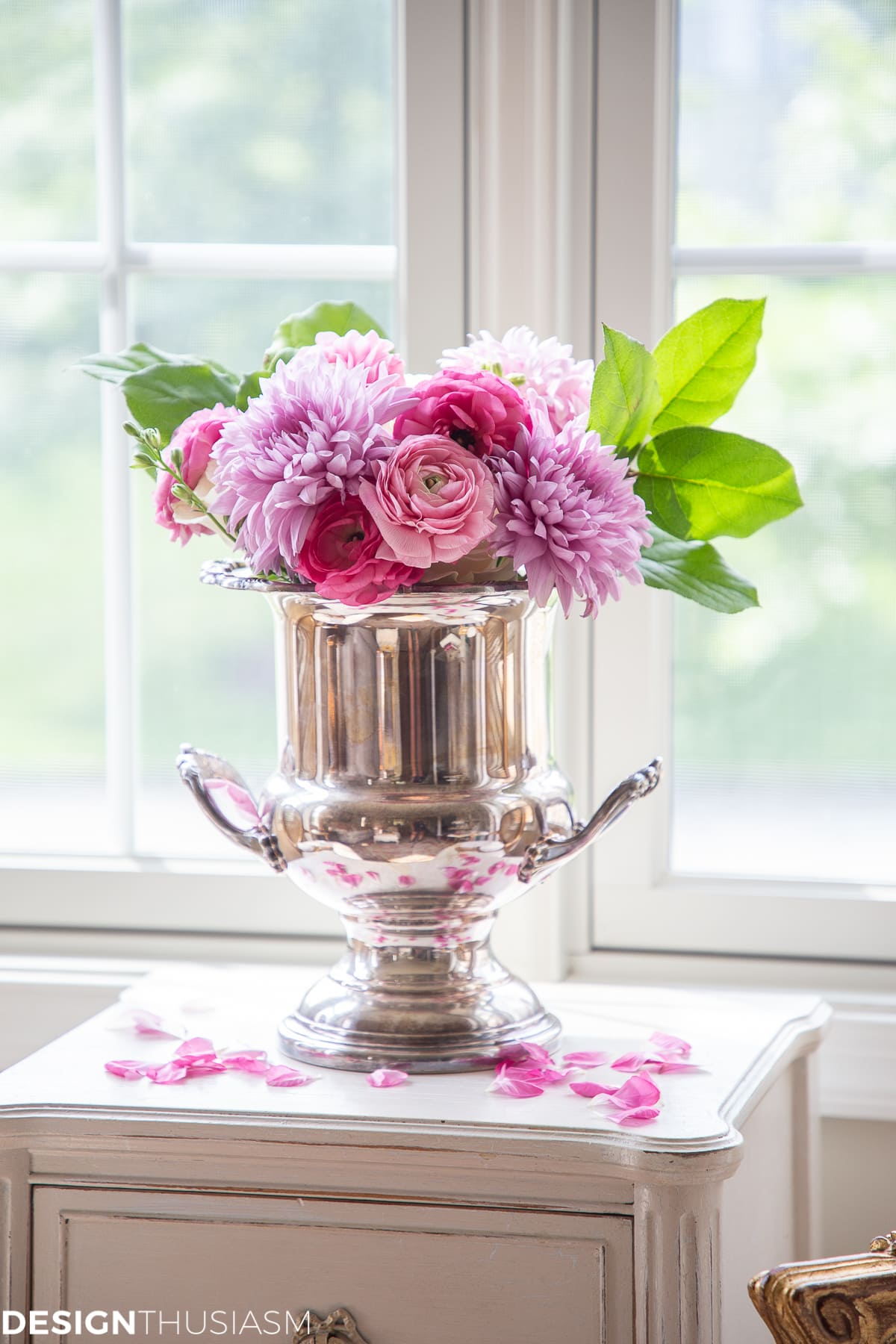 flowers in a silver bucket