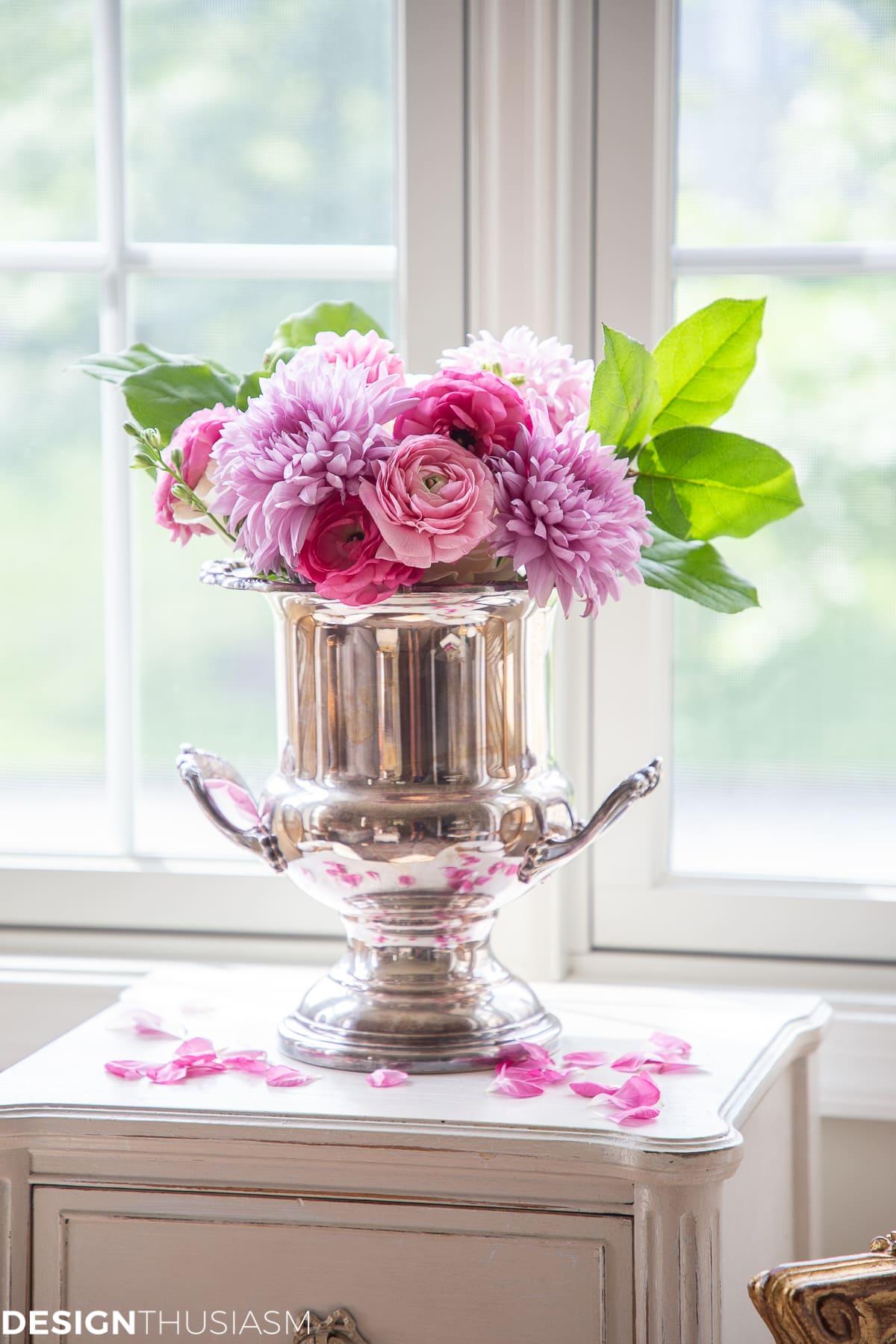 flowers in a silver bucket