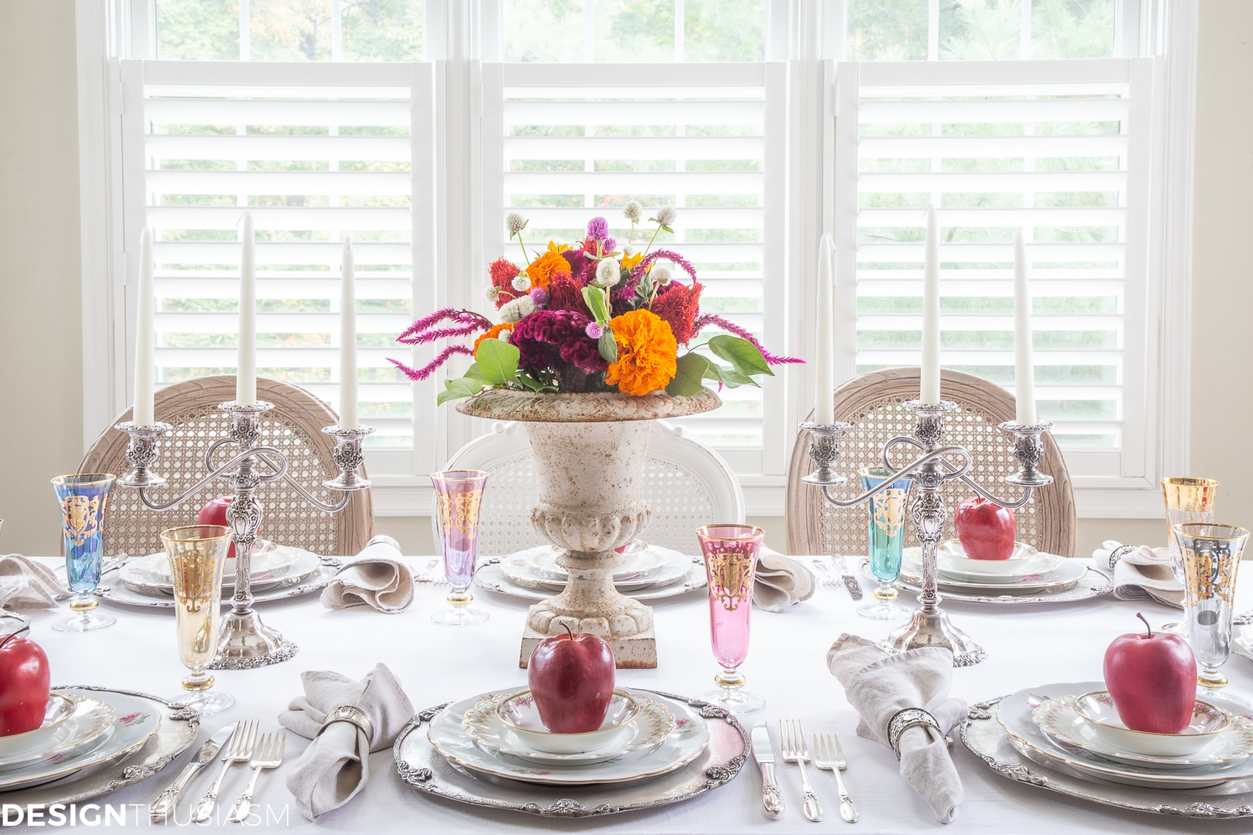 fall table setting with apples and colorful flowers