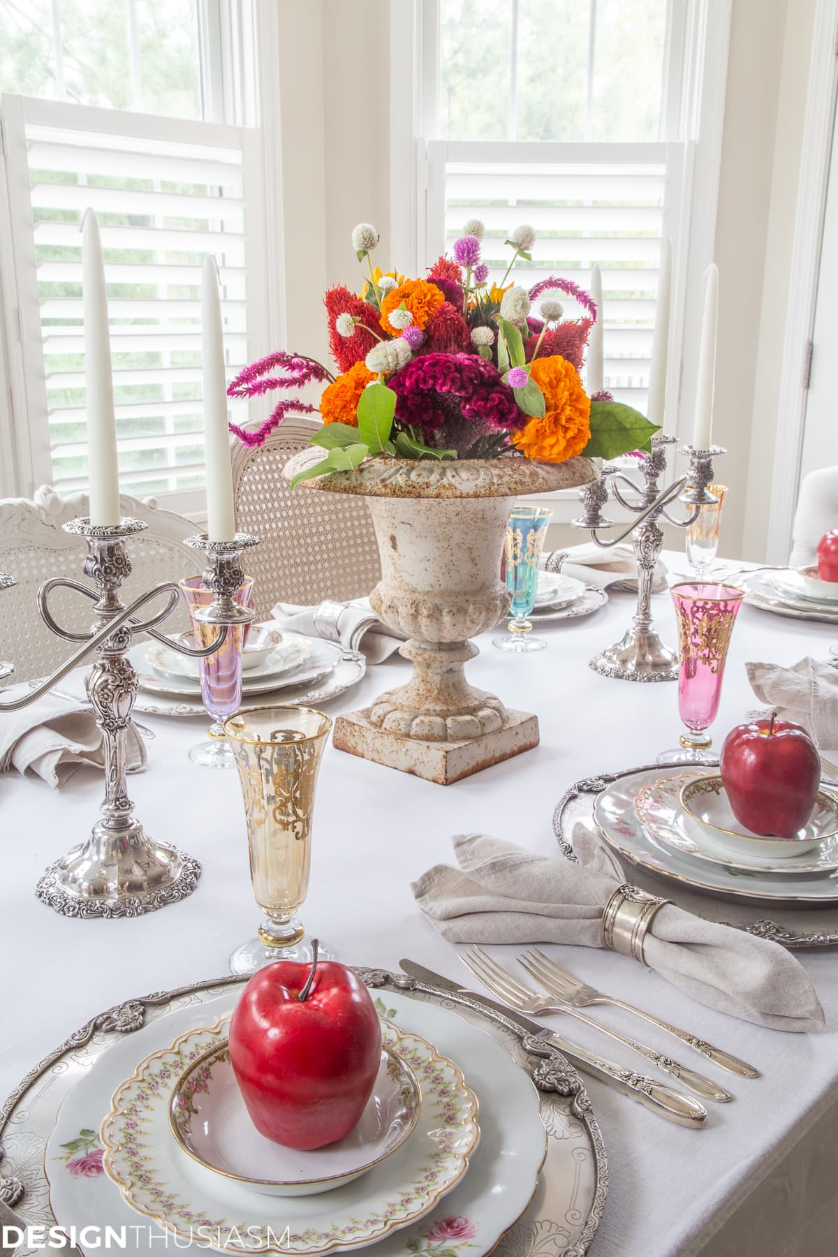 fall table setting with apple decor and colorful glasses