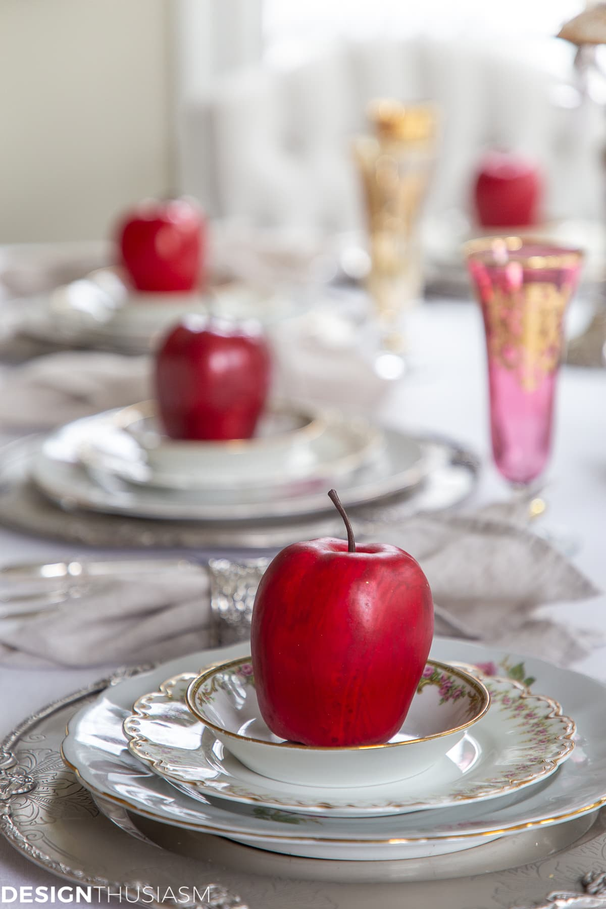 fall table setting with apples on the plates
