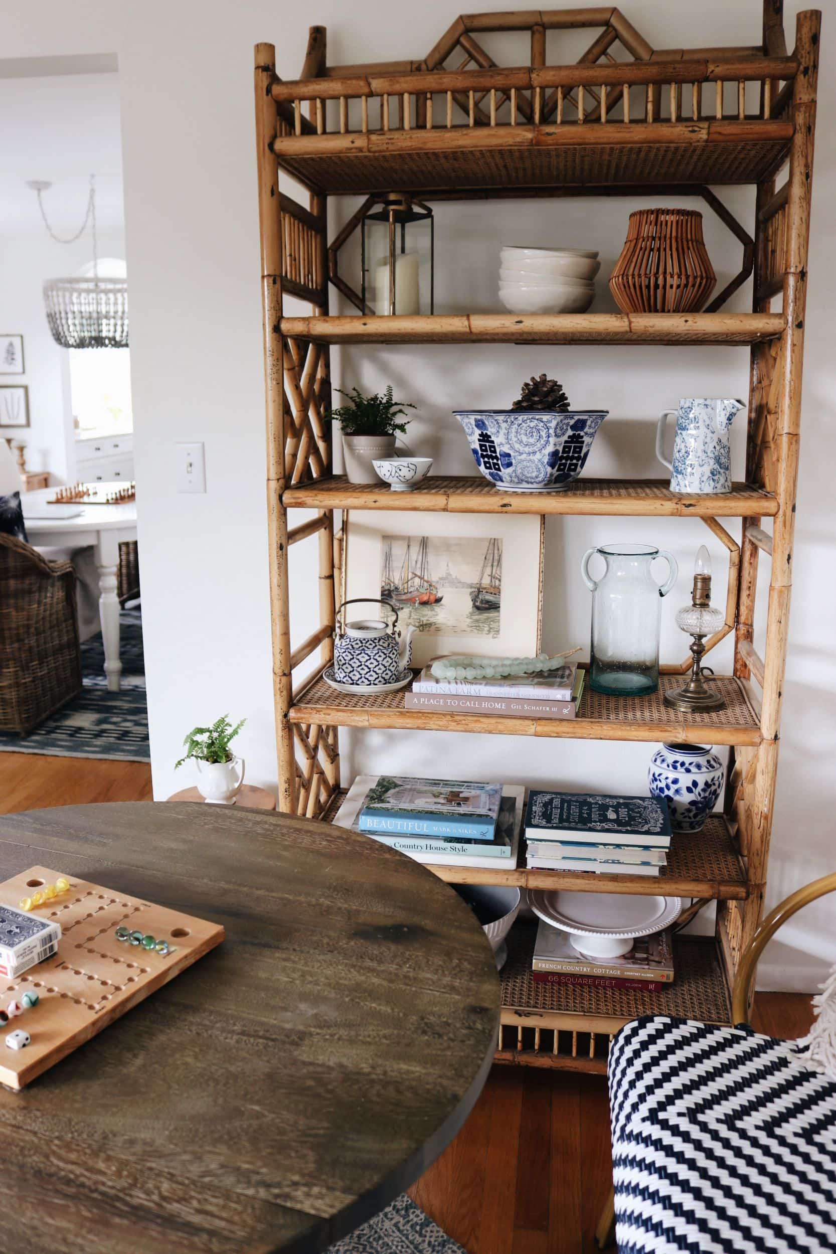 Game-table-with-rattan-bookshelf-coastal-style-the-inspired-room