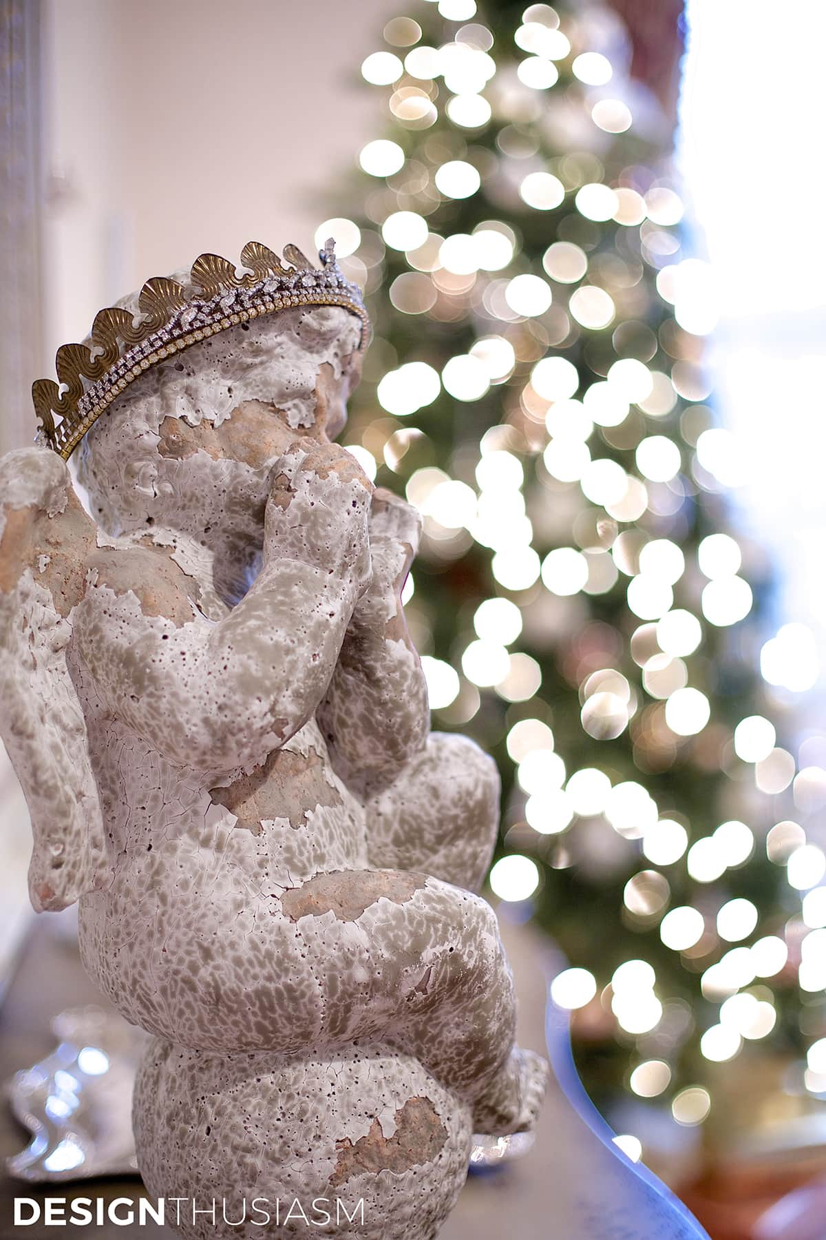 French country cherub with Christmas tree