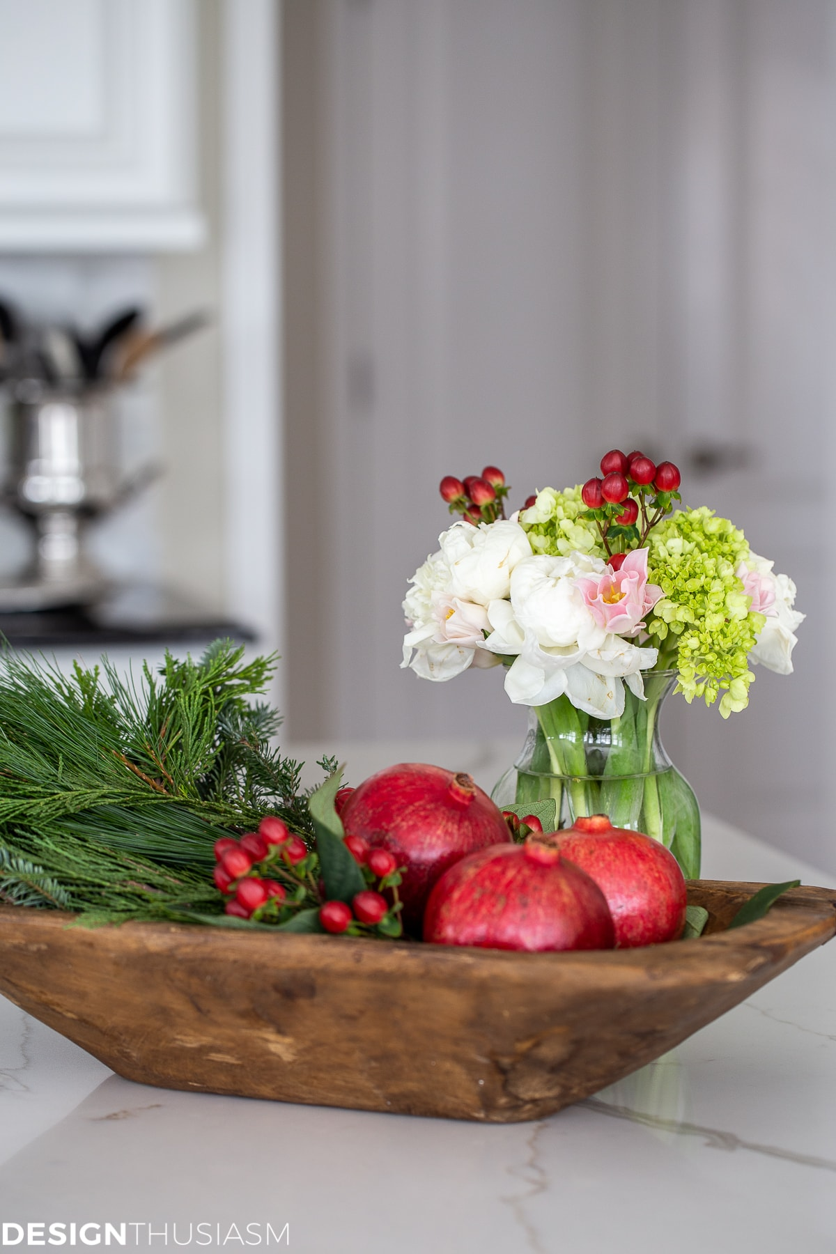 dough bowl vignette with flowers and pomegranates