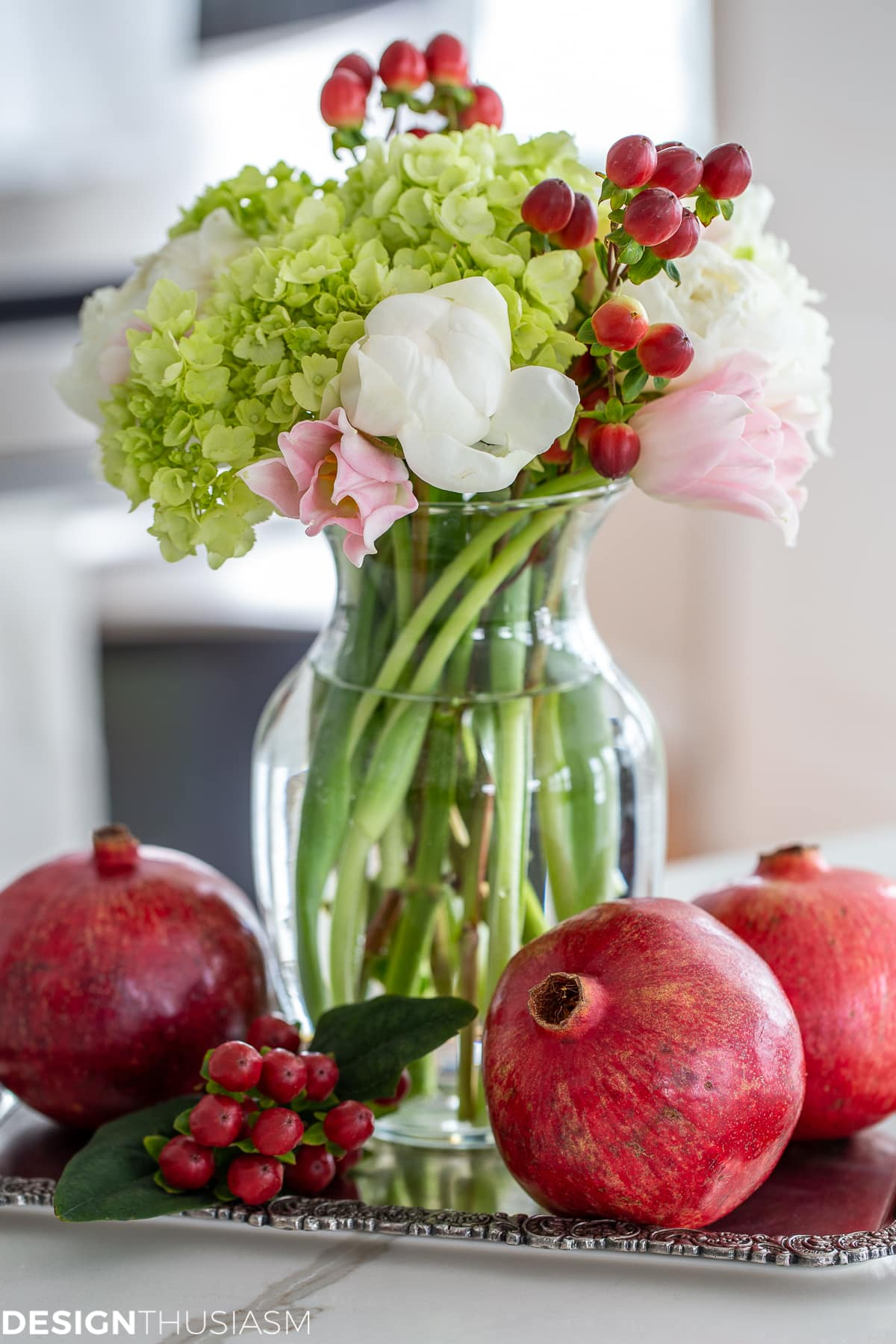holiday vignette with flowers and pomegranates