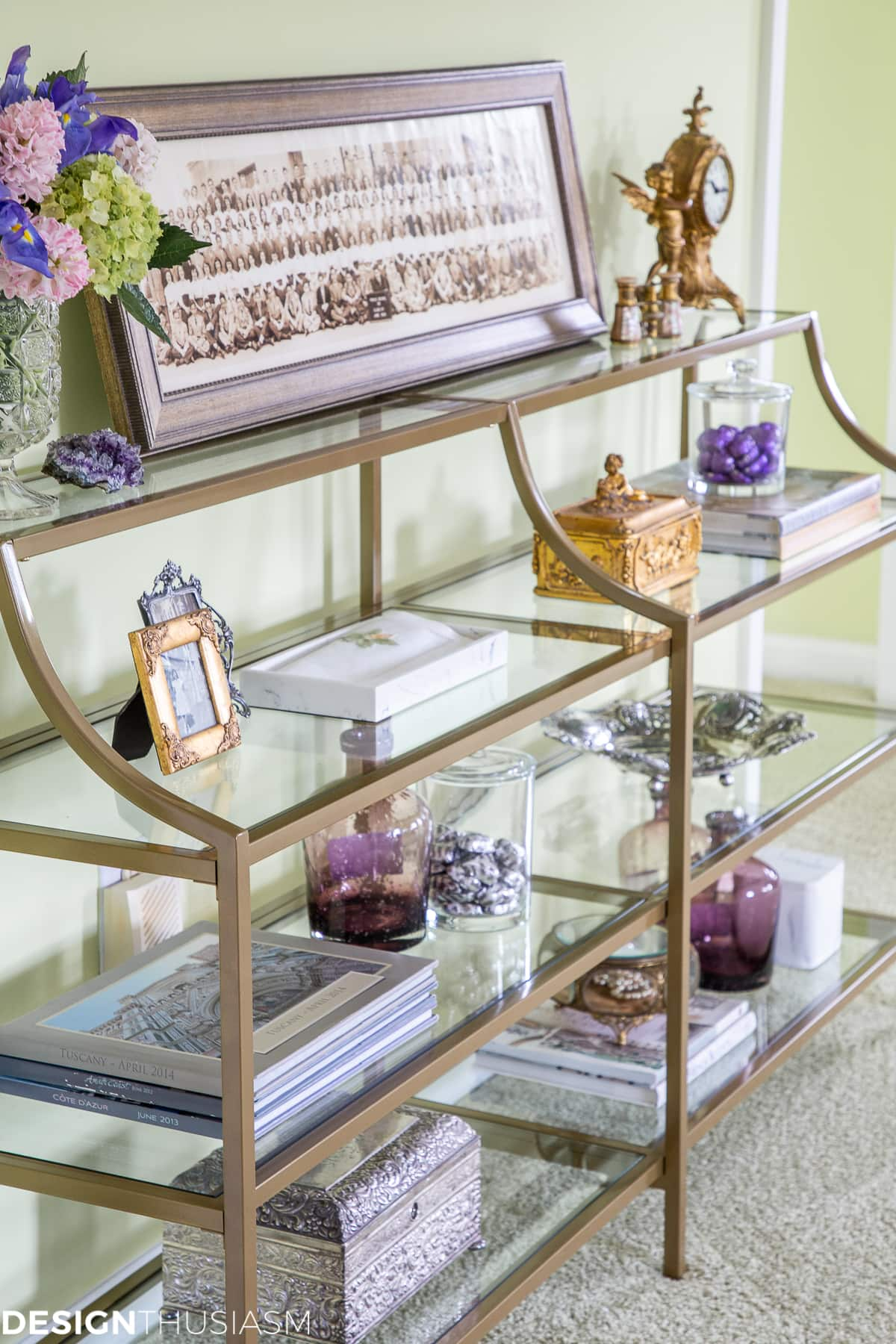 decorated shelves on metal and glass console