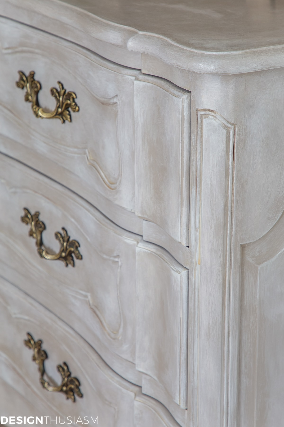 detail closeup of vintage french painted dresser