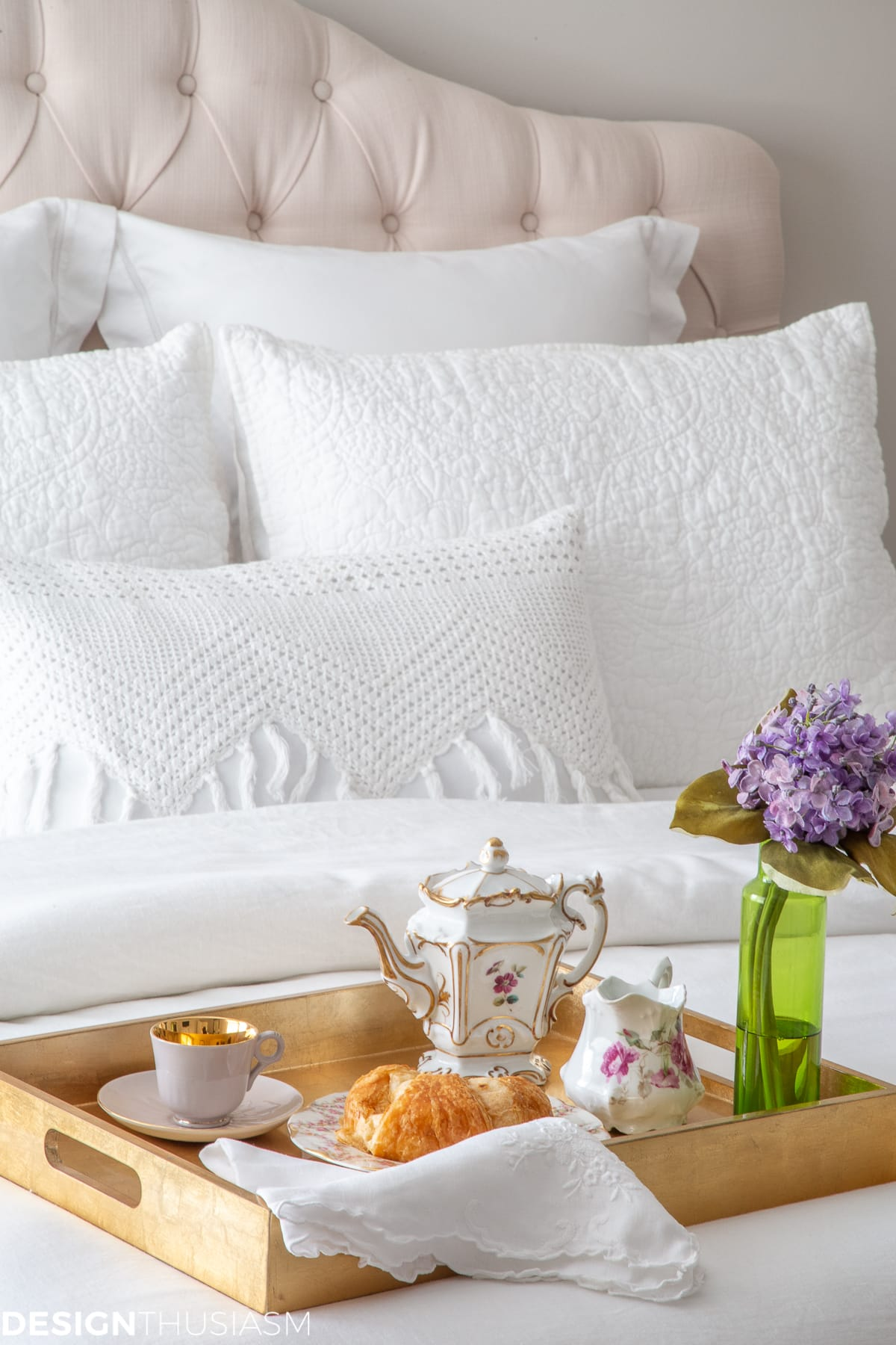 luxury white bedding with breakfast tray