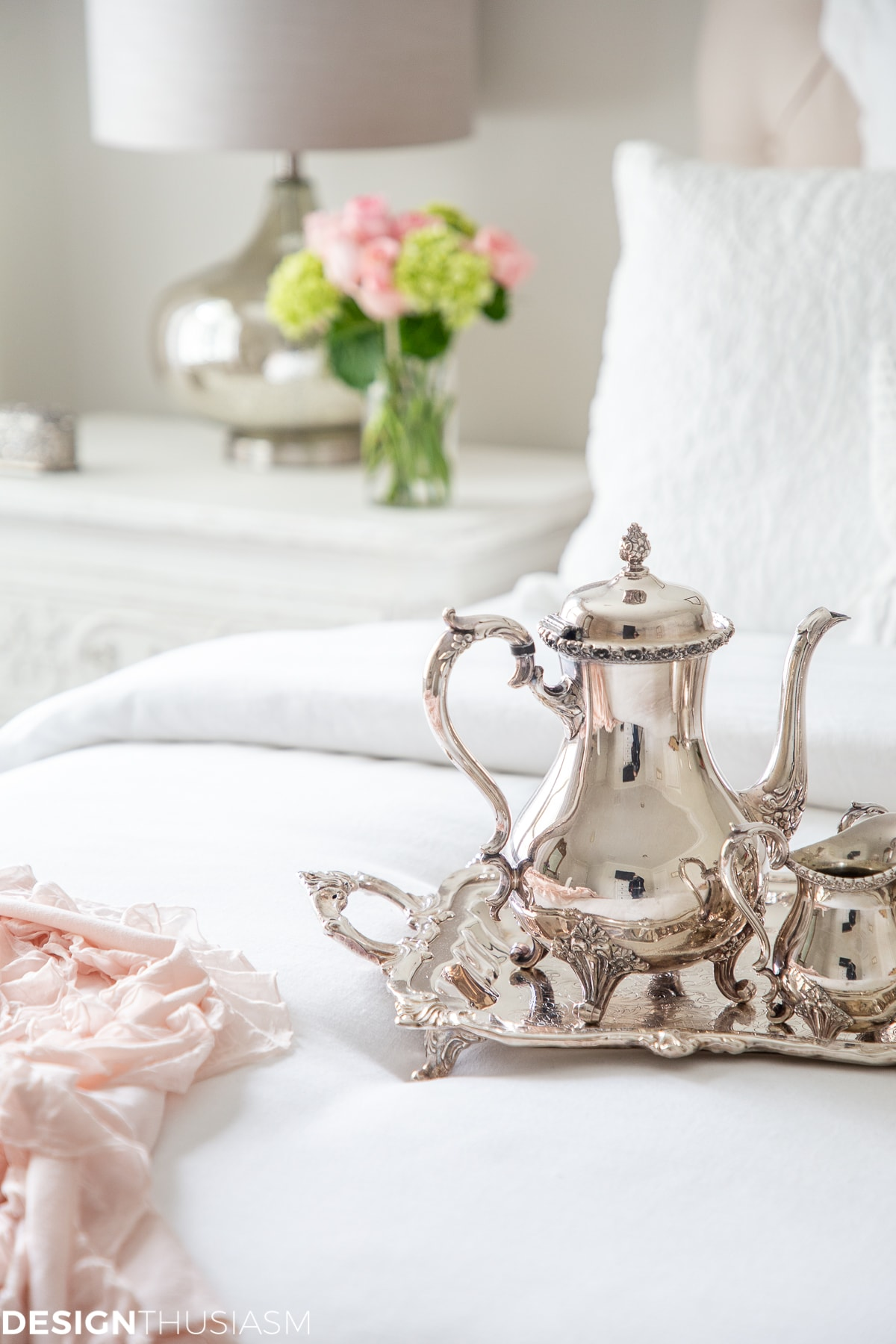 white bedroom with silver tea set