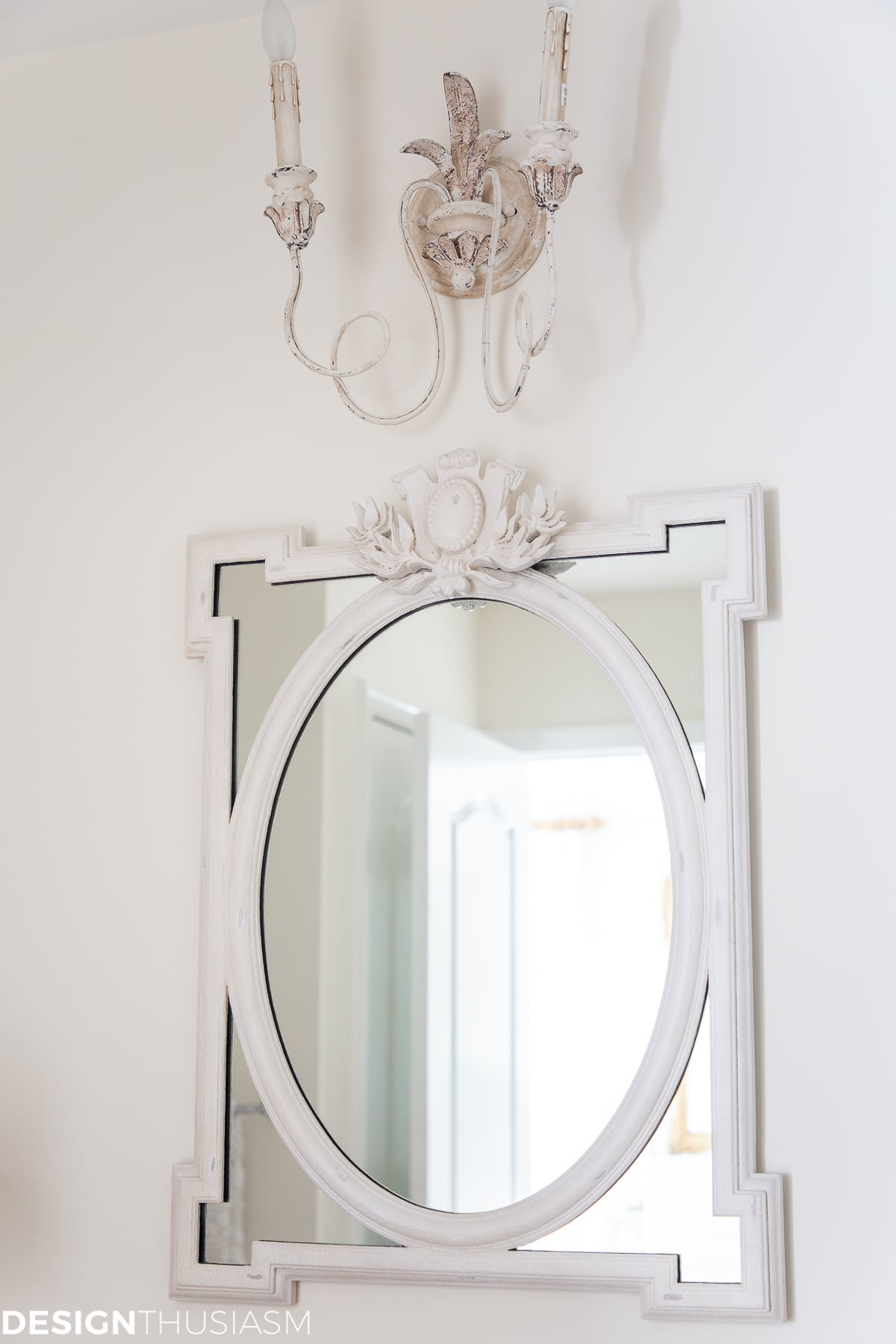 bathroom mirror and sconces