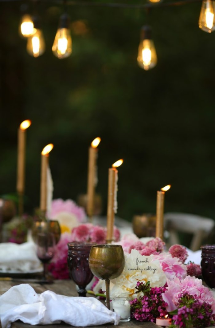 Candles and peonies on the table