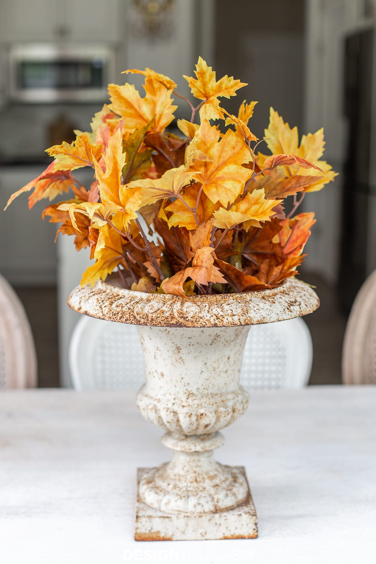 fall leaves in a garden urn