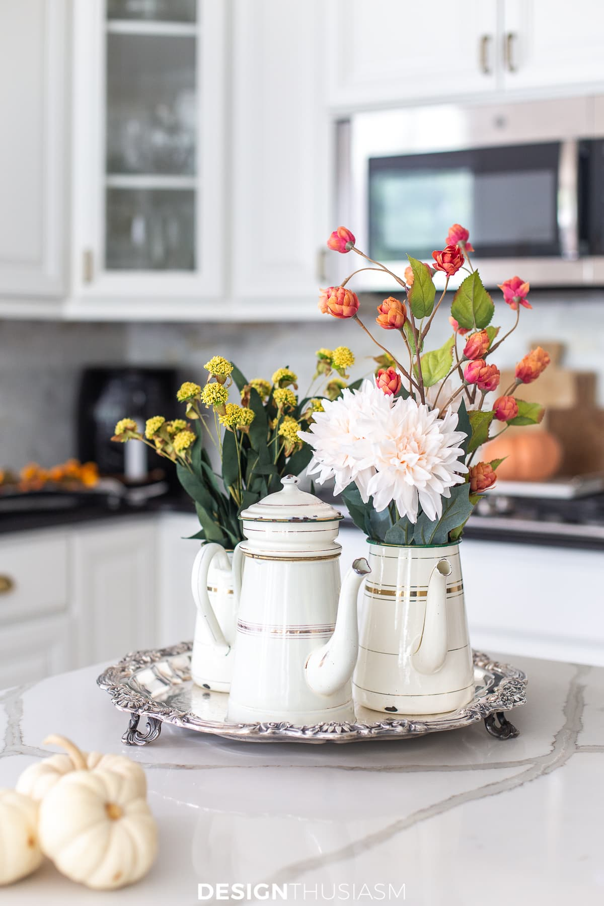 fall flowers in vintage coffee pots