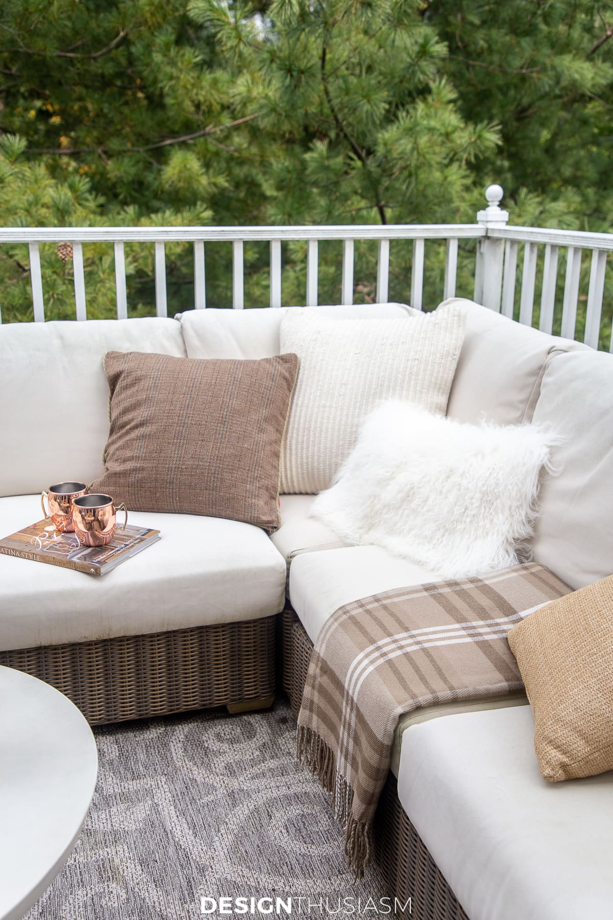 fall pillows and throws on the porch