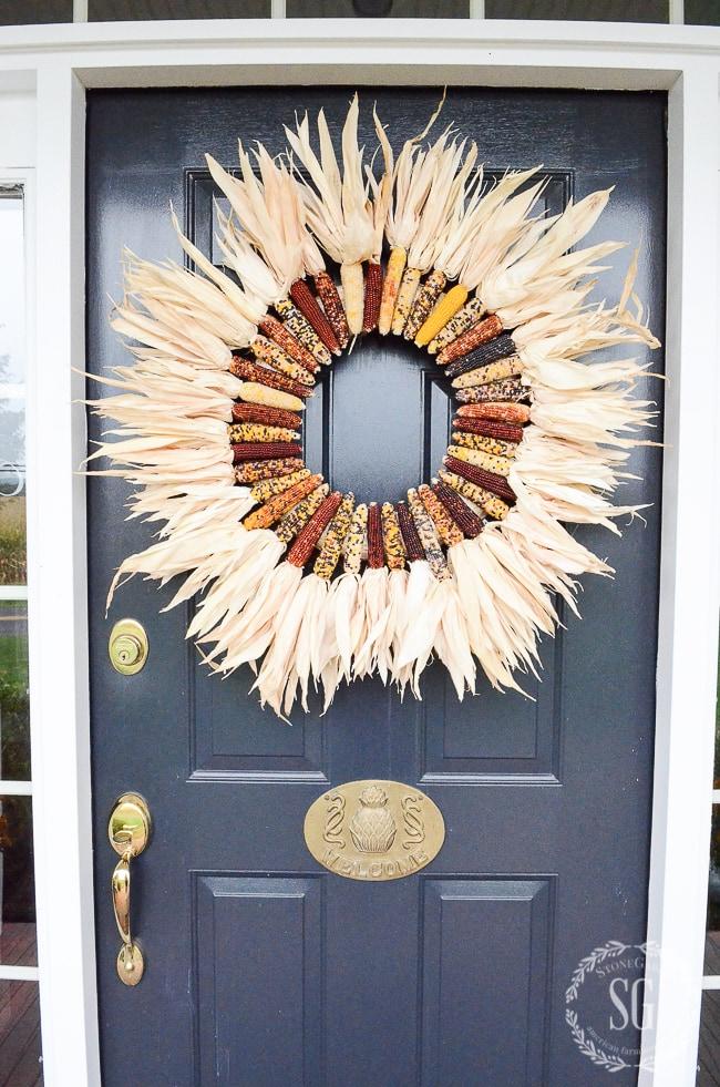 corn wreath stone gable