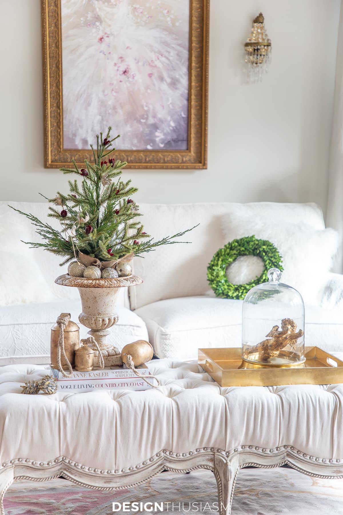 mini christmas tree on an ottoman