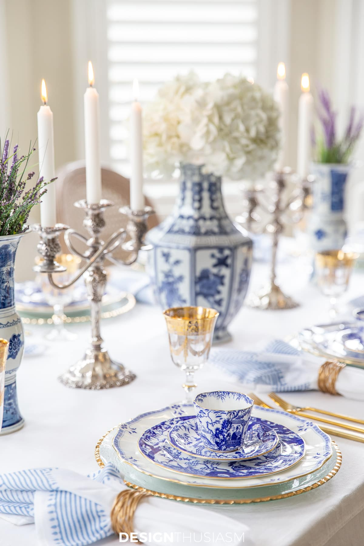blue and white china table setting with white hydrangeas