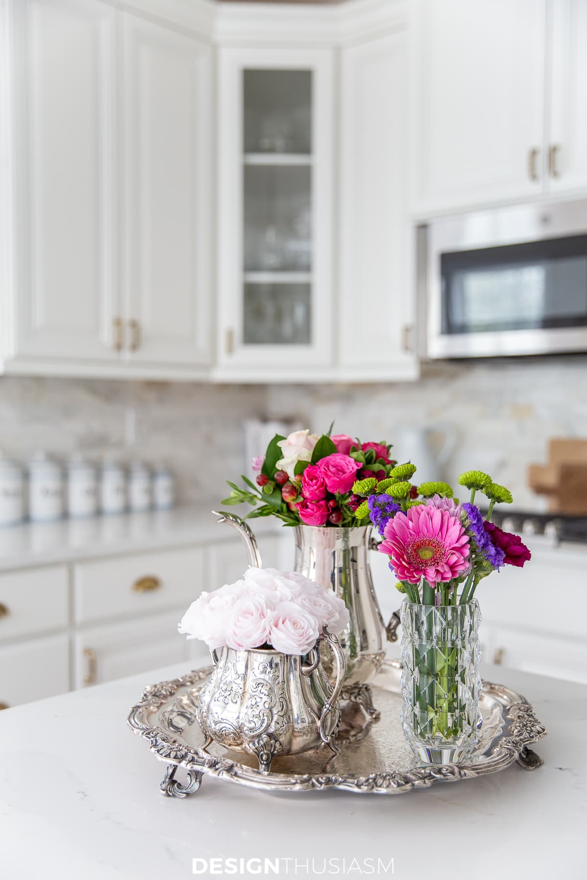 pink flowers in a white kitchen