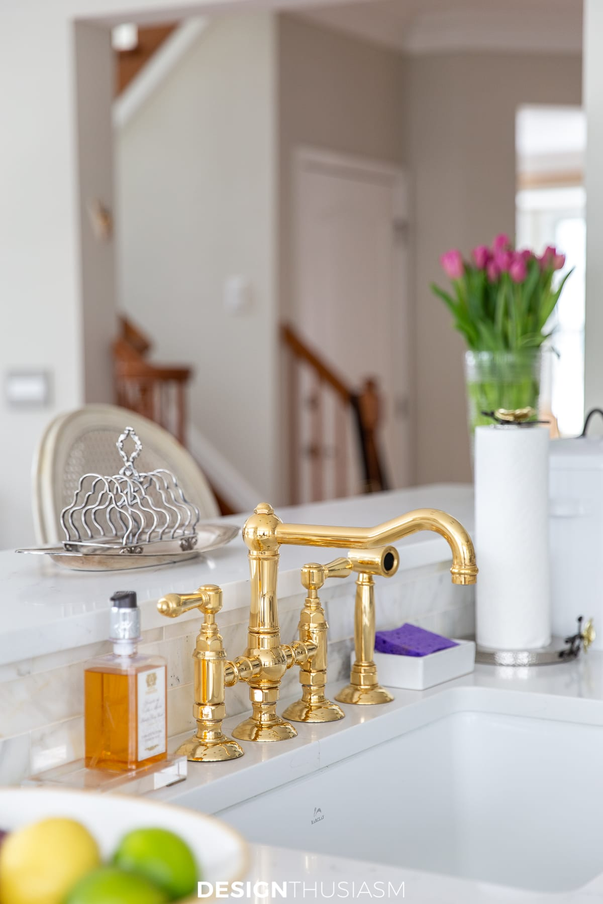 white kitchen with brass faucet