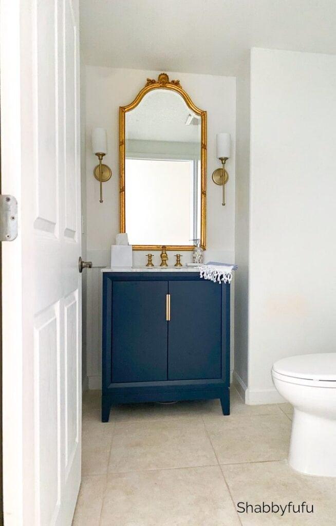 Stylish Powder Room Renovation In Blue