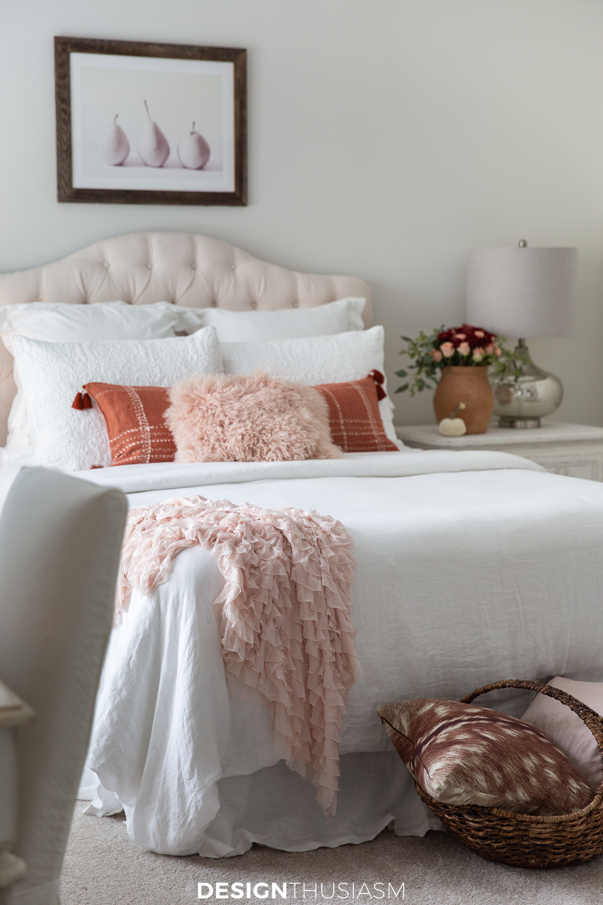 Fall bedroom decor in a white bedroom